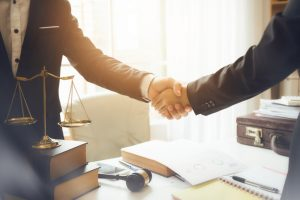 Handshake,Between,Attorneys,And,Clients,After,Agreeing,To,Enter,Into